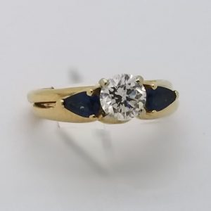 14k Ring with .60ct Round Brilliant Diamond and Sapphire jacket